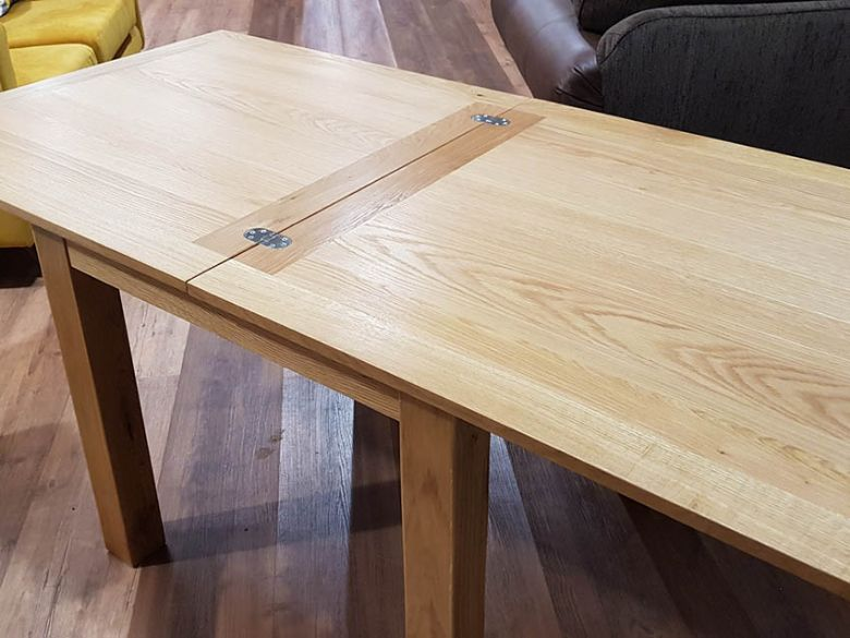 Oxford oak square extending dining table - extended hinges exposed