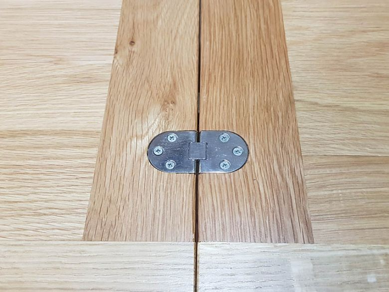 Oxford square oak dining table extended - hinges exposed