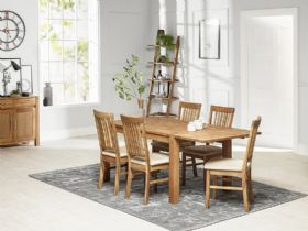 Durham dining table with additional leaf and fabric chairs